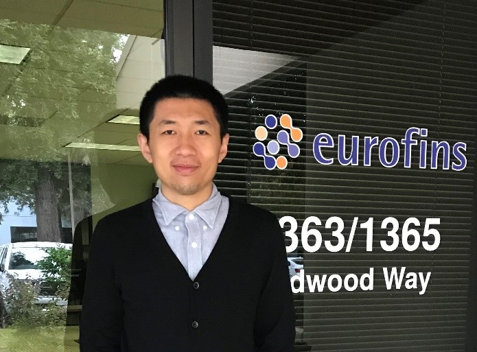 Dr. Hong You, standing in front of the front door of the Eurofins Supplement Analysis Center
